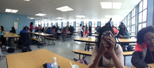 Many Kenwood students are sitting with their peer groups at their lunch tables as they enjoy their free period of lunch.