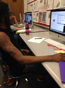 Senior, Jason Barfield, is concentrating on his photo project on a hot day. His tattoo representing his city, Chicago, on his arm is easily viewable on this nice day.