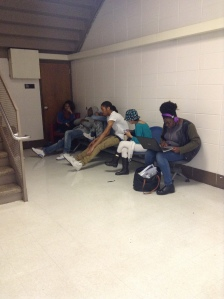 Some Kenwood students, of different grade levels, that are just hanging out during 8th period, socializing and on their technology