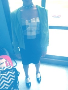 Freshman Erin Gales takes black and white far.  She pulls an white and black striped tub top of with a fitted black skirt.  Her narrow toed flats show her unique side but not as much as the green wool jacket.
