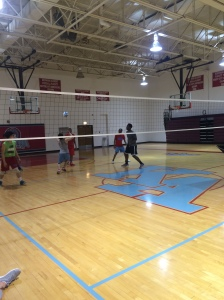 2.The Scene: The Males Volleyball team is working hard in practice today. They're trying to prepare themselves for their playoff game later in the week.