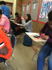 A group of kenwood students are in a geometry room so into their phones that they are not paying attention to each other. Phones are a big distraction and stop teens from interacting and socializing with one another when they are together.