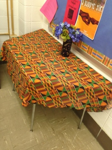 A class table is decorated with African-American colors to symbolize black heritage.
