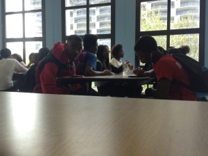Kenwood freshman sit together at a table in 4th period lunch as they enjoy socializing and eating lunch at the same time