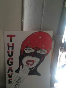Portrait says thug ave and shows a lot of blood on her head more likely transforming the women into a thug after feeling nothing but betrayal coming from thug ave and street of blood and despair