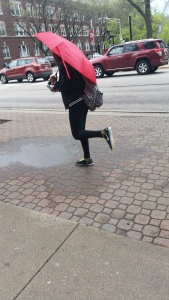 Senior Kennedie Duvall makes the best of a rainy day after school by jumping into and around puddles.
