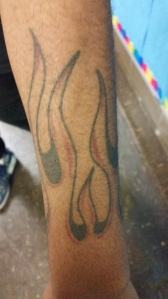 Flames on Junior Jonathan Rhymesgeorge's arm represents the danger of life and the strength people have to get through everything.