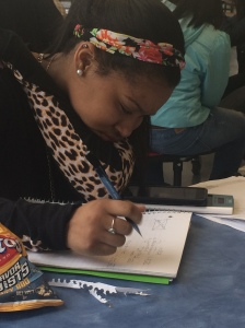 Freshmen Jataya Lee is doing her geometry homework and on her phone at the same time. She puts her phone on top of her calculator showing that her phone is a priority.
