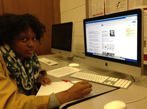 Kenwood Junior Malani Hughes works on a presentation during a substitute class for Ap Government.