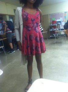 Kenwood,eighth grader, Madison Christmas shows her vibrant side by pulling off a brightly colored dress with floral patterns being brought out by a darker shade of purple.  She pulls this off with a beige cardigan bringing more attention to herself.