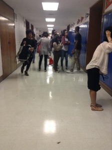 After school, these students, who seem like upperclassmen, are standing around their lockers on their first floor hall seem to communicate with each other while showing off their fashionable sides