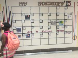 Kenwood Student walks off after feeling an excited emotion after looking at the Kenwood broncos schedules final calendar that gives the student happiness that so much exciting events are on the way and school is almost coming to an end.