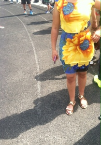 Kenwood Junior brings out the bright colors on the hottest day of this spring so far.  The bright yellow and different shades of blue brings attention to her nice skin tone.  Topping her outfit off with gold flats more a different approach to fashion other your plain sandals.
