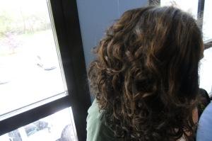 Kenwood sophomore plays in his curly natural hair.
