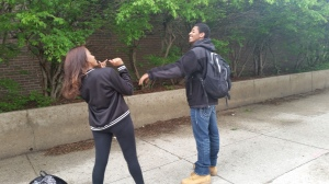 Senior Kennedie Duvall and Junior Anthony Davis playfully fight outside the school.
