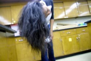 Kenwood sophomore Mariah Taylor shakes her long natural blown out hair.